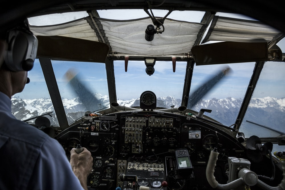 pilot driving plane during daytime