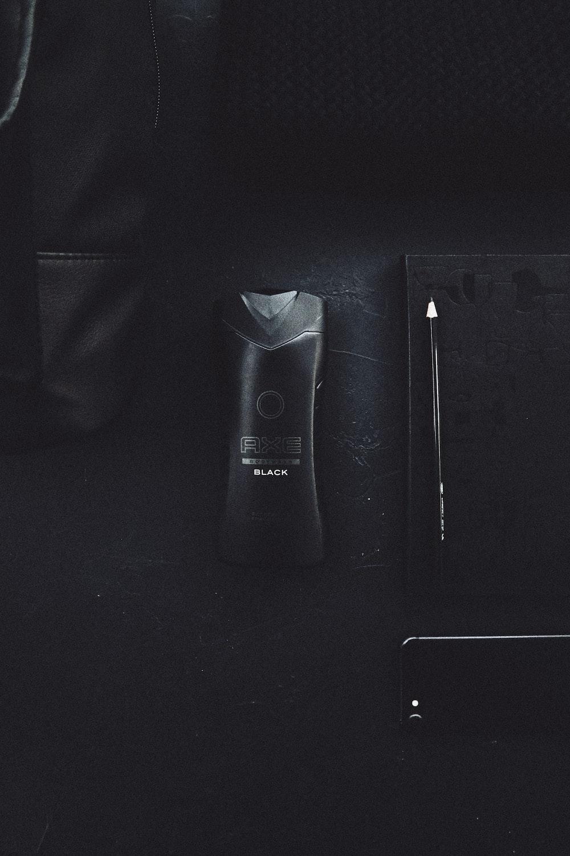 Axe Black deodorant bottle on black surface