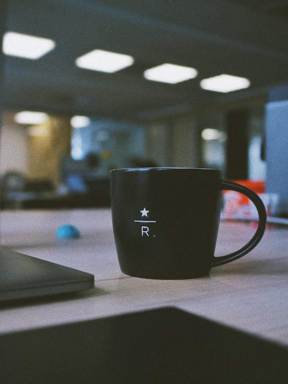 black ceramic mug on wooden table