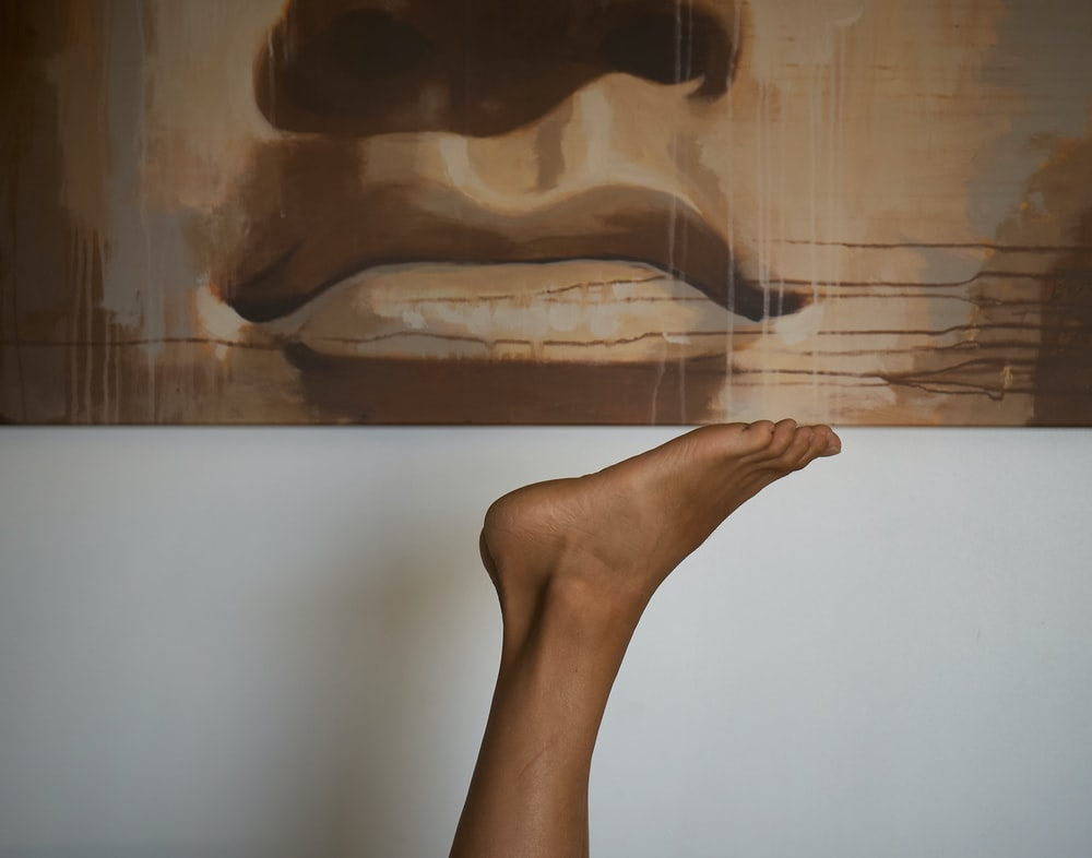 person foot under painting
