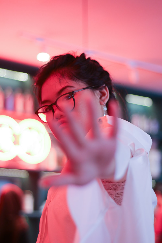 woman reaching camera