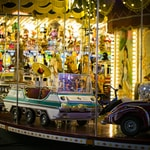 vehicle carousel on carnival at night