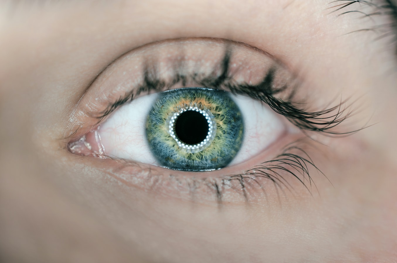 Light being reflected from a blue-hazel eye
