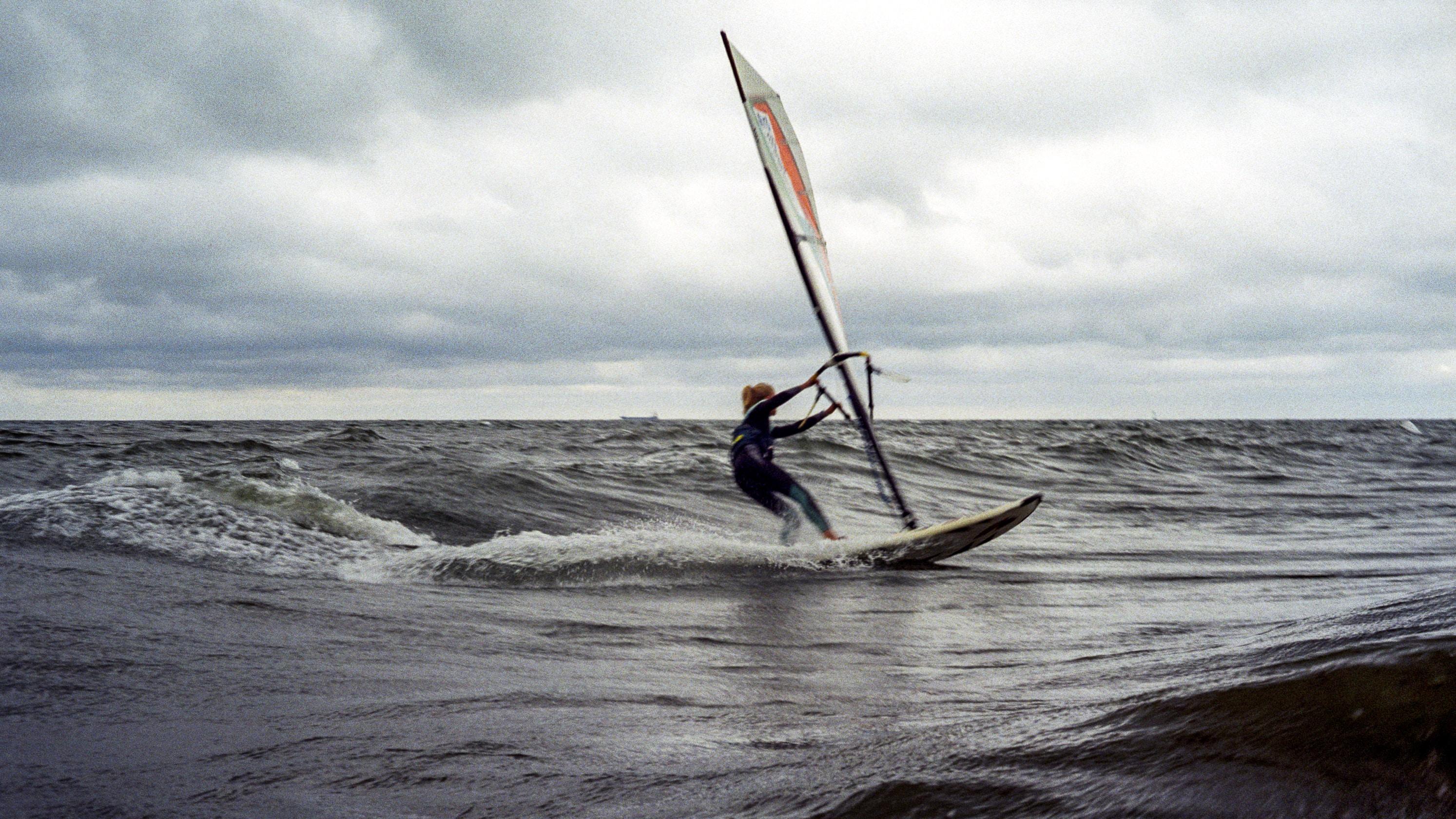 man on sailboat during daytime