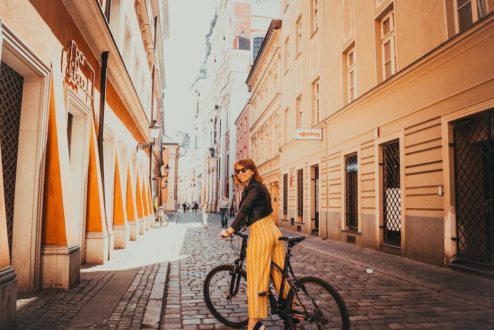 woman riding black hardtail bike