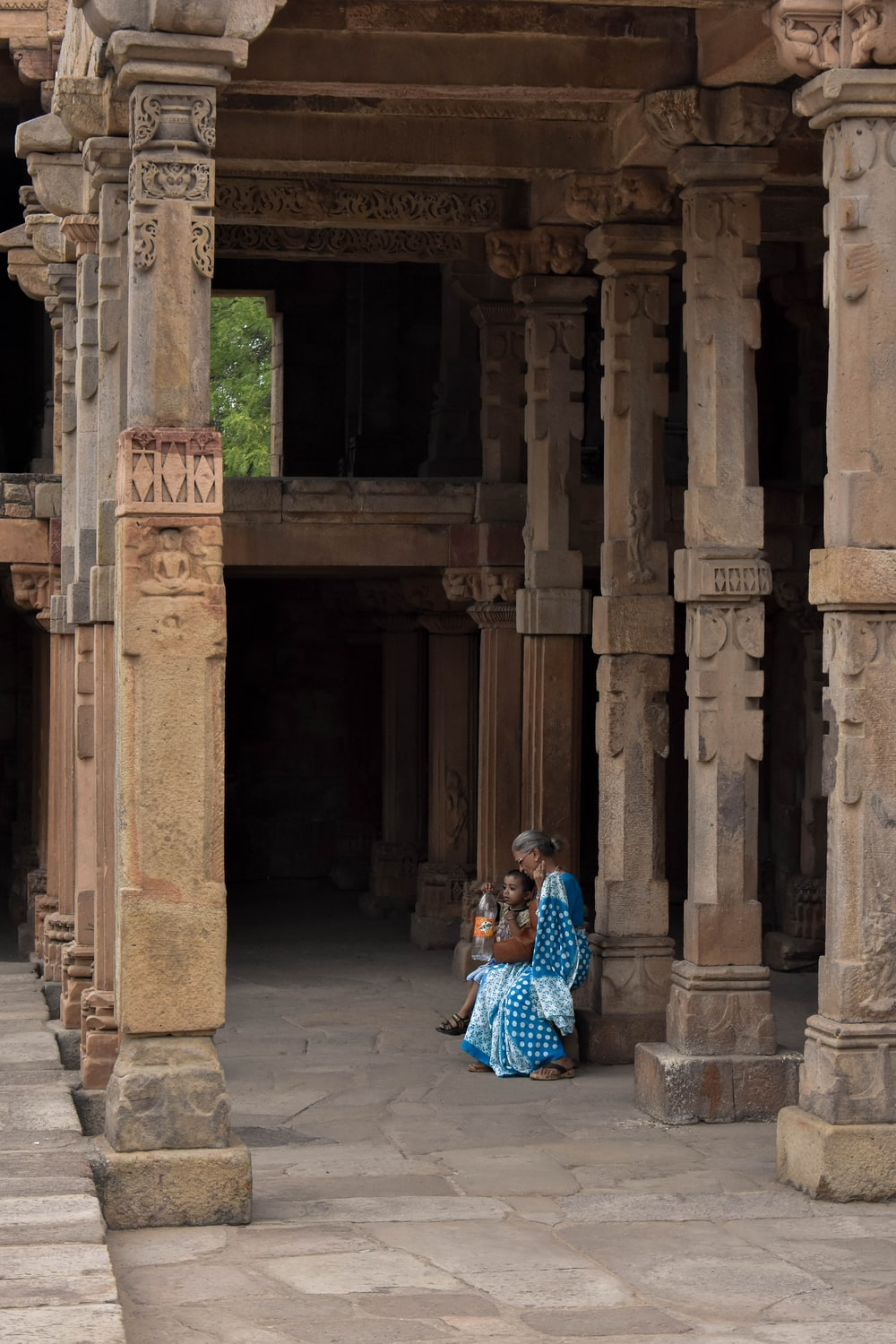 woman and child sitting inside building