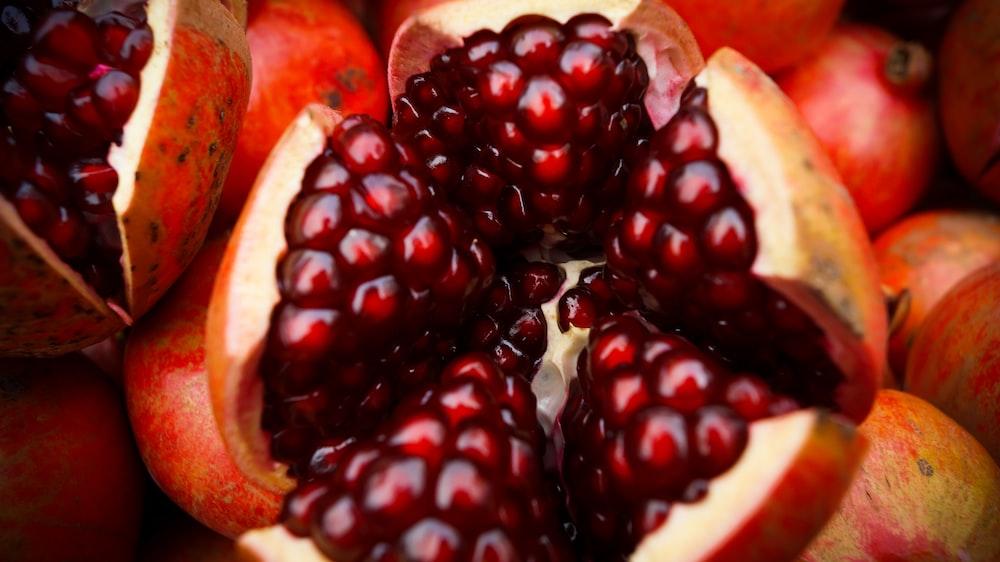 close-up photo of sliced pomegranate