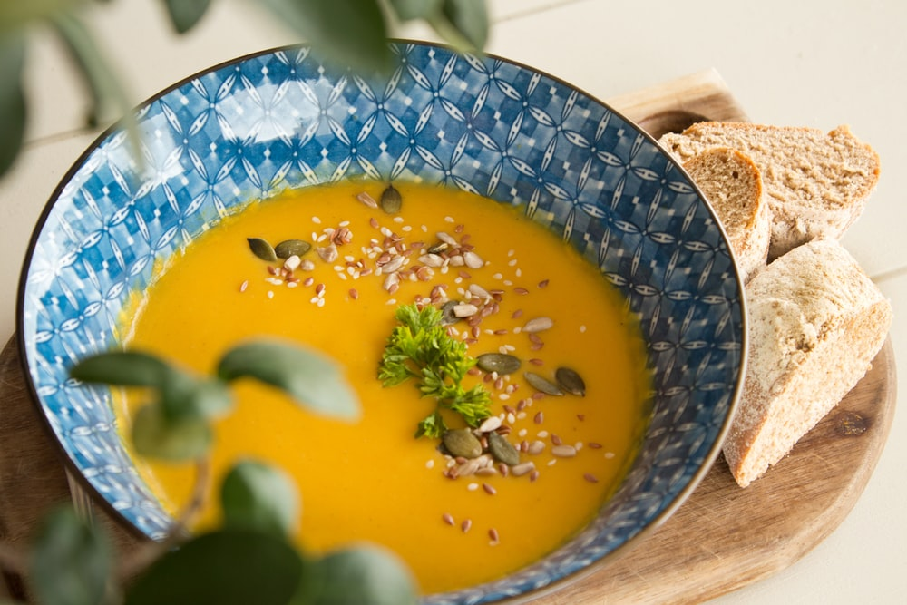soup with sesame seeds and bread
