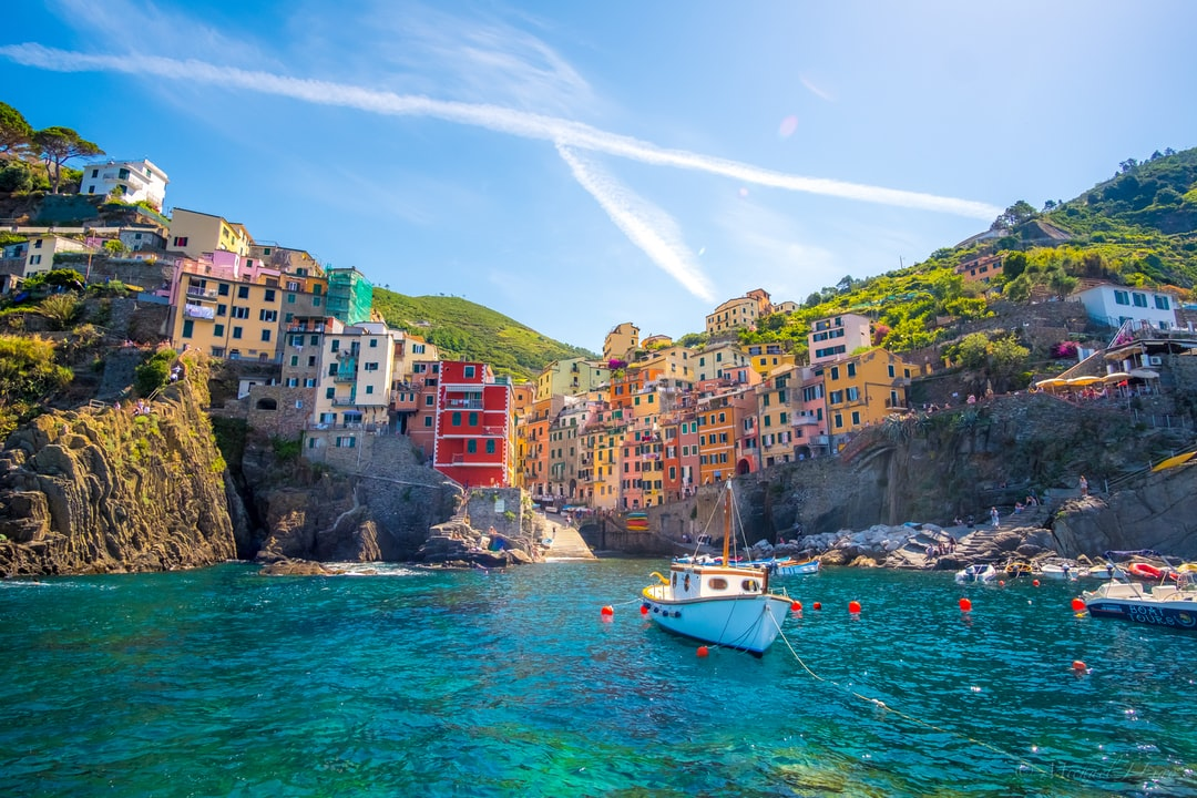 During the summer it can be difficult to escape the swarms of tourists that visit the famous seaside towns of Cinque Terre. In order to capture this beautiful photo of Riomaggiore I had to climb to the end of the rock jetty that protects boats in the harbor.