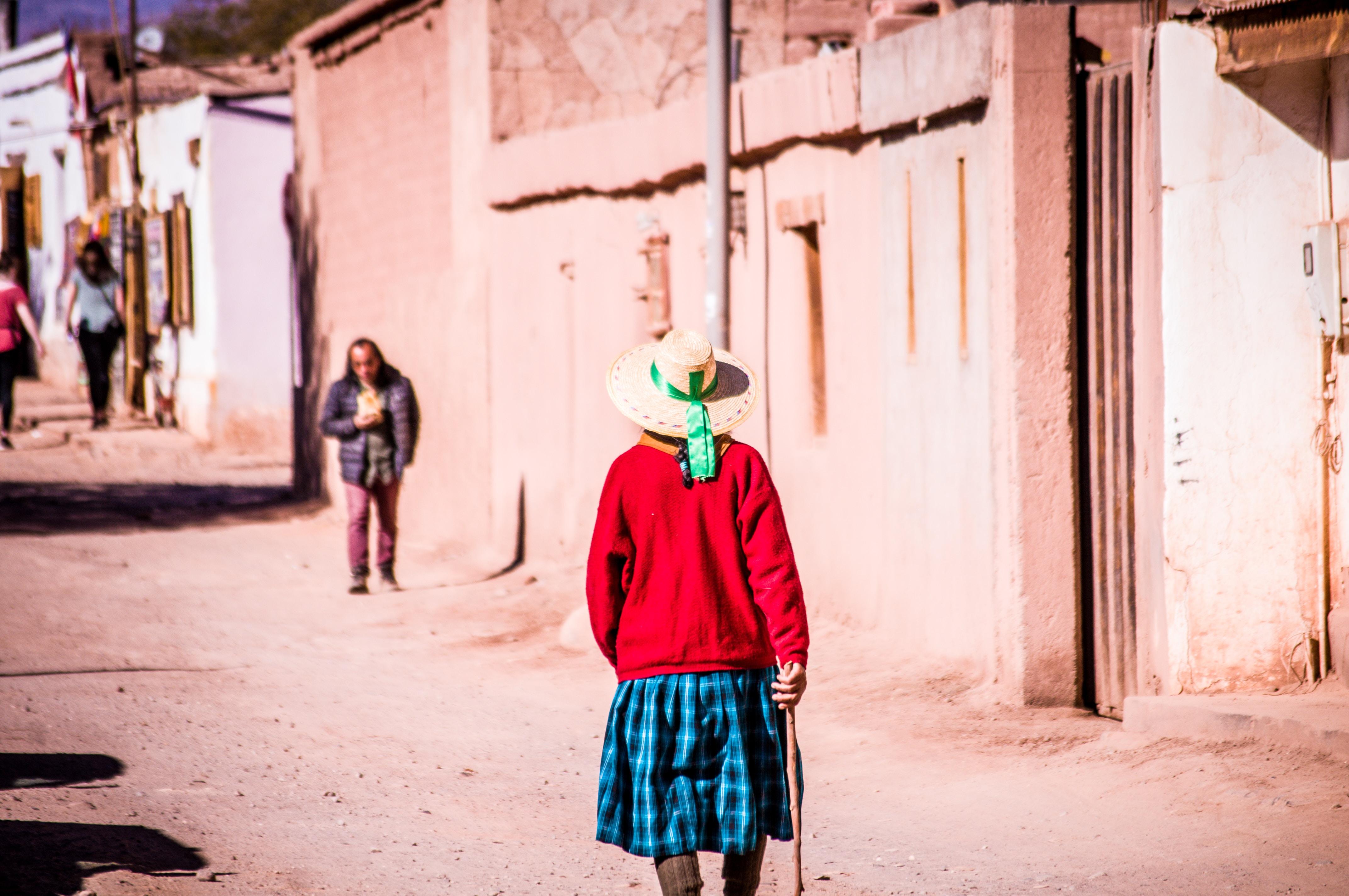 woman walking on gray road