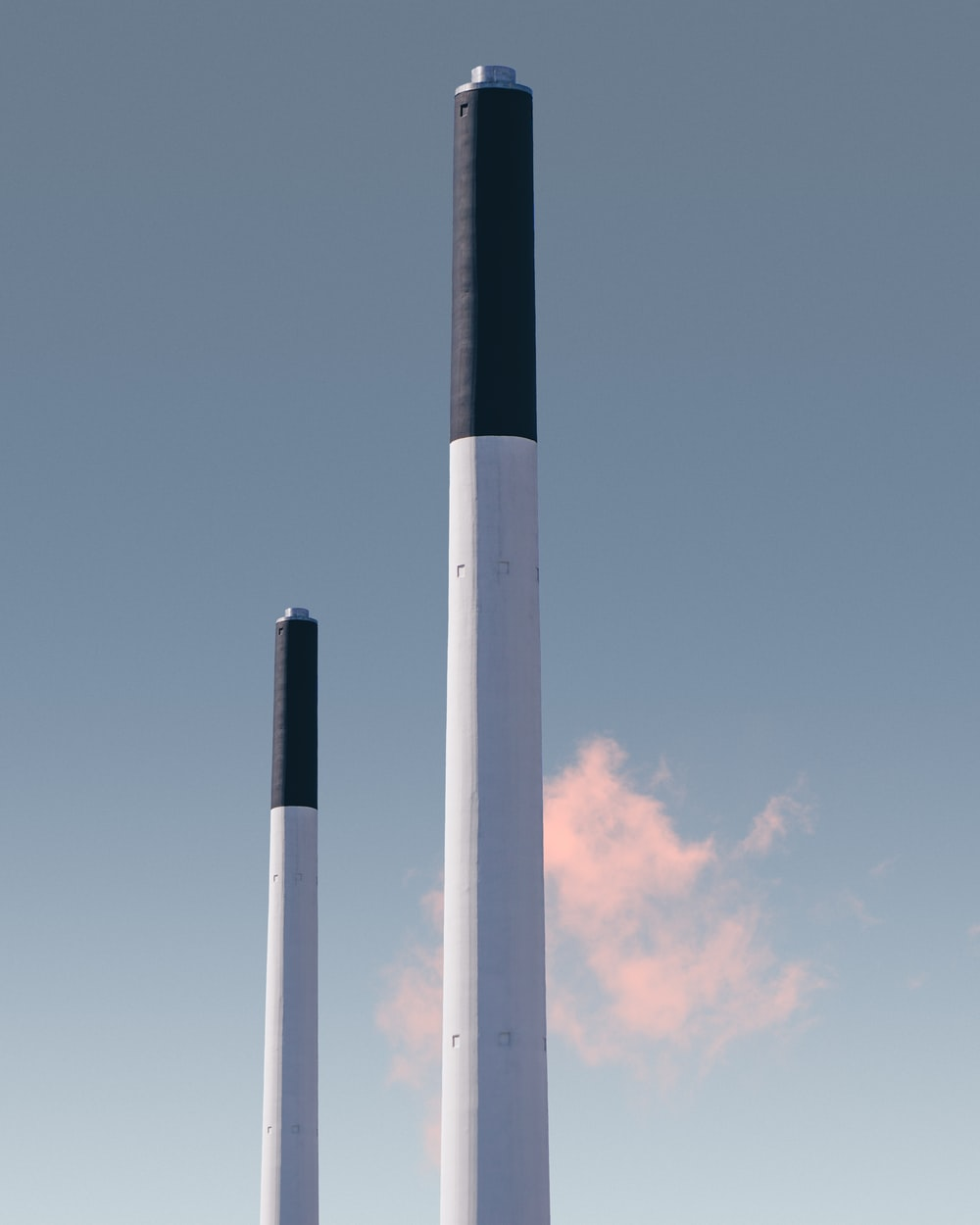 two white-ad-black posts under blue sky