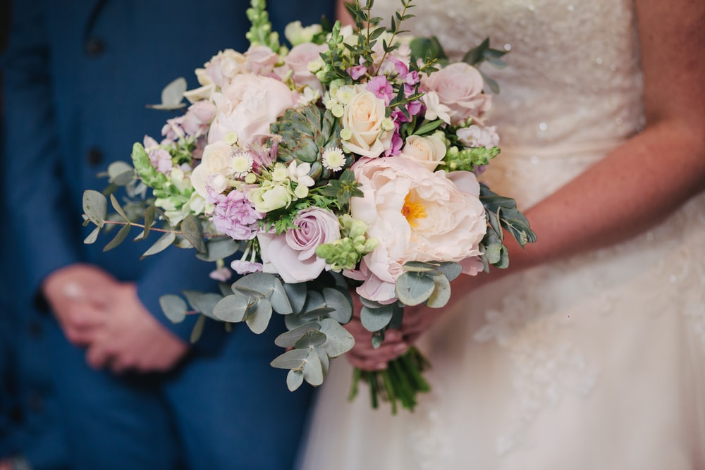 bride holding bouquet of white and pink flowers