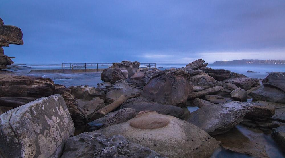gray stones near body of water