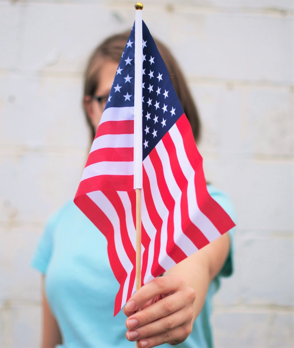 person holding USA Flag