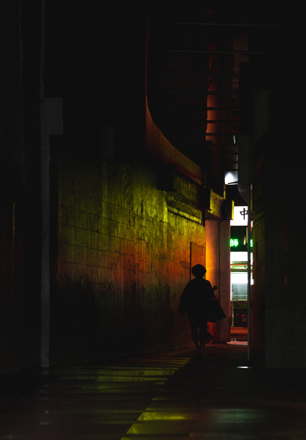 silhouette of person walks on hallway