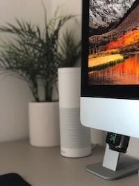 selective focus photograph of silver iMac