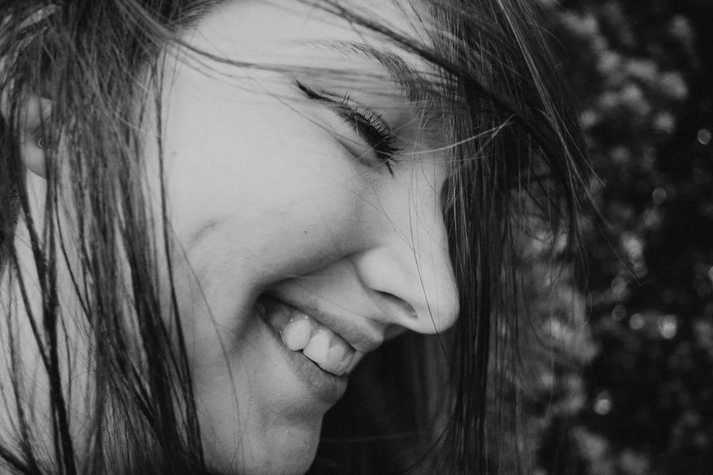 grayscale photo of smiling woman