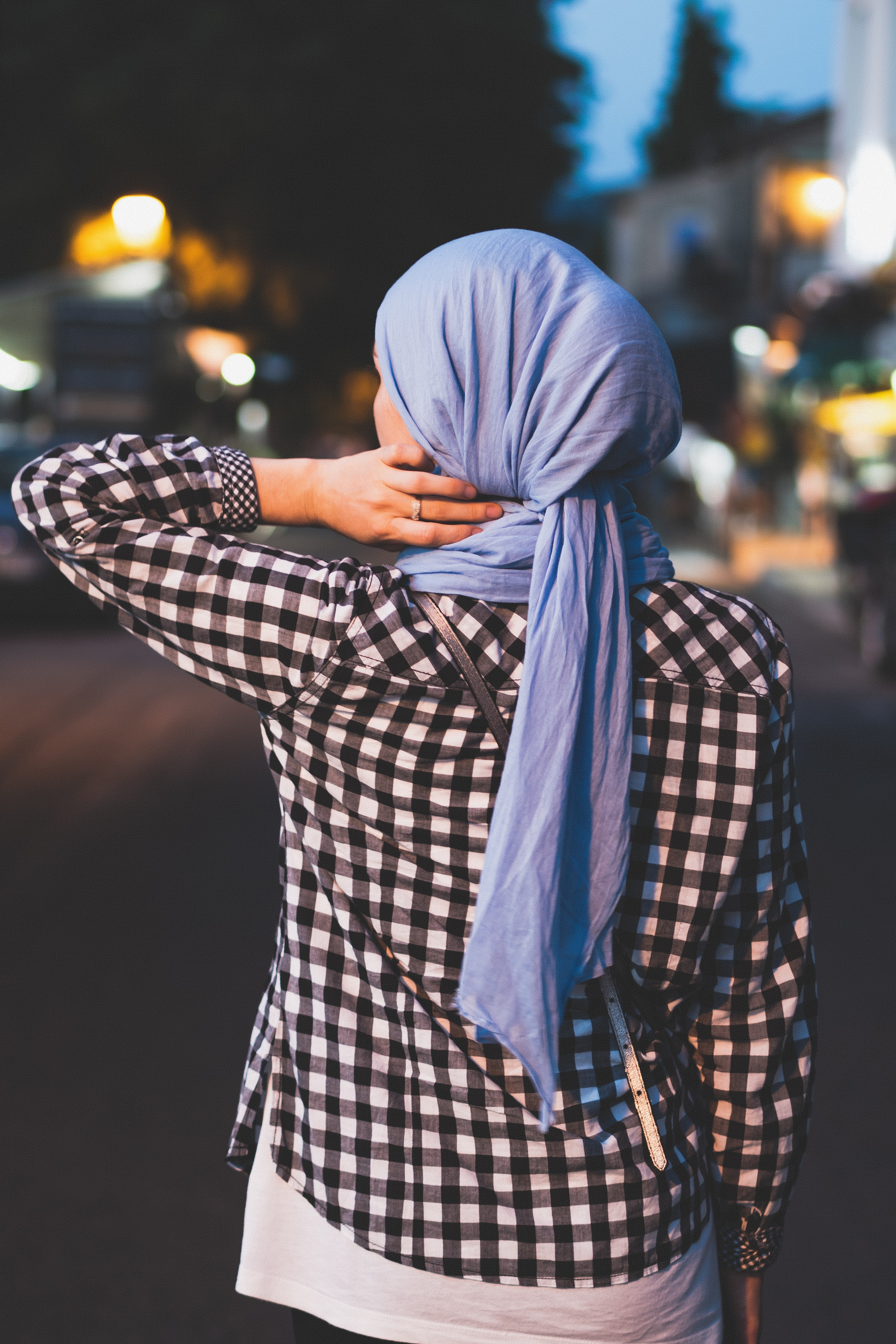 selective focus photograph of person wearing blue headscarf