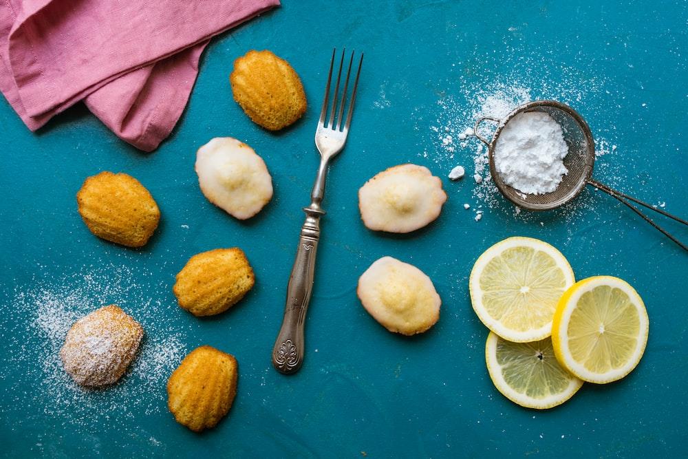 stainless steel fork beside of sliced lemons