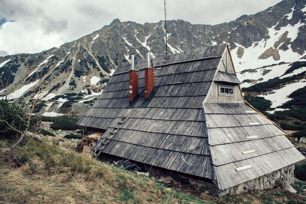 gray house beside green grasses