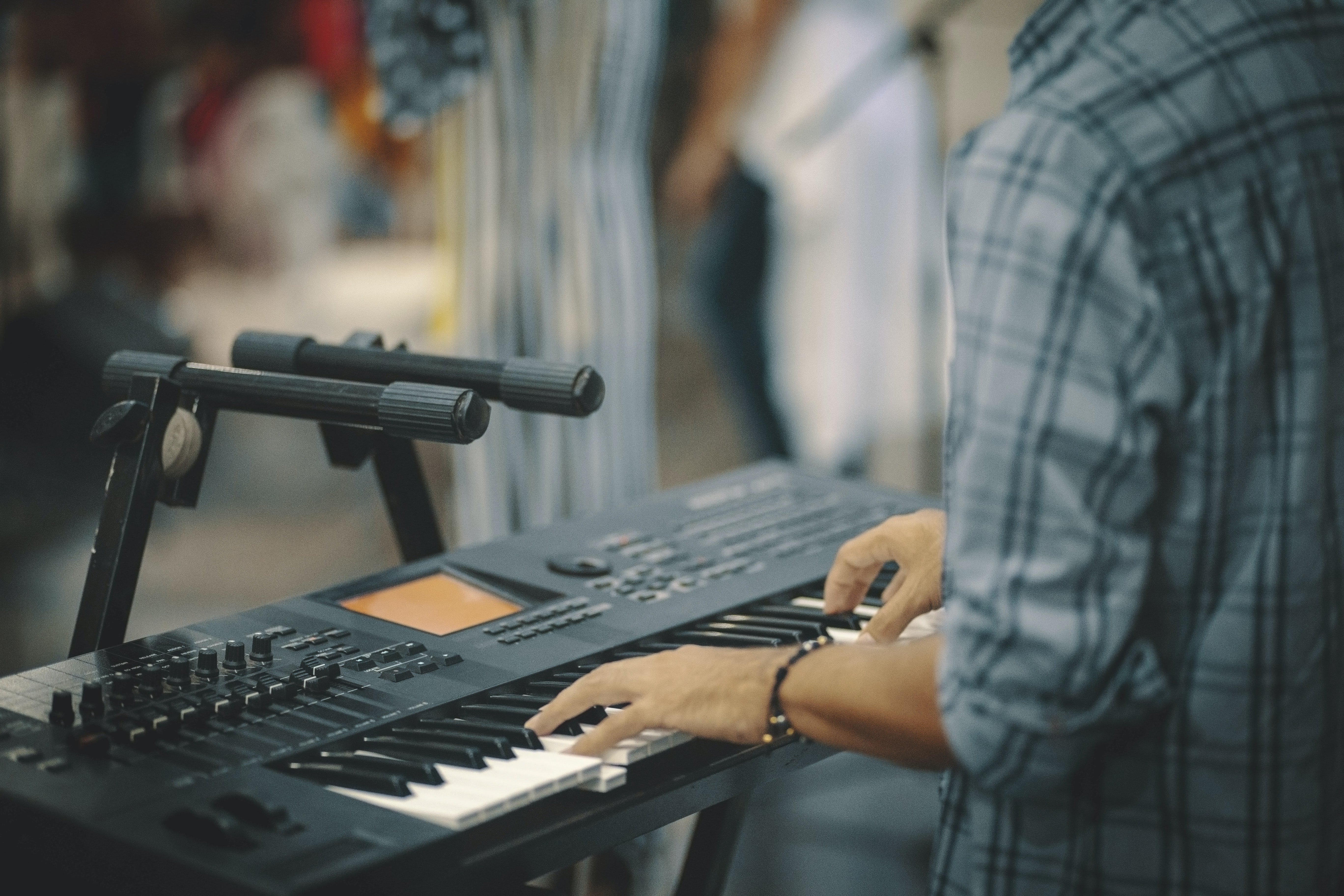 person playing electronic keyboard