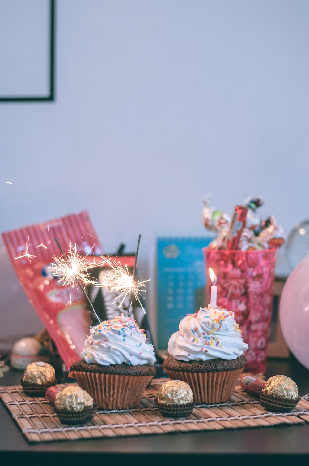 candles and sparkler on cupcakes