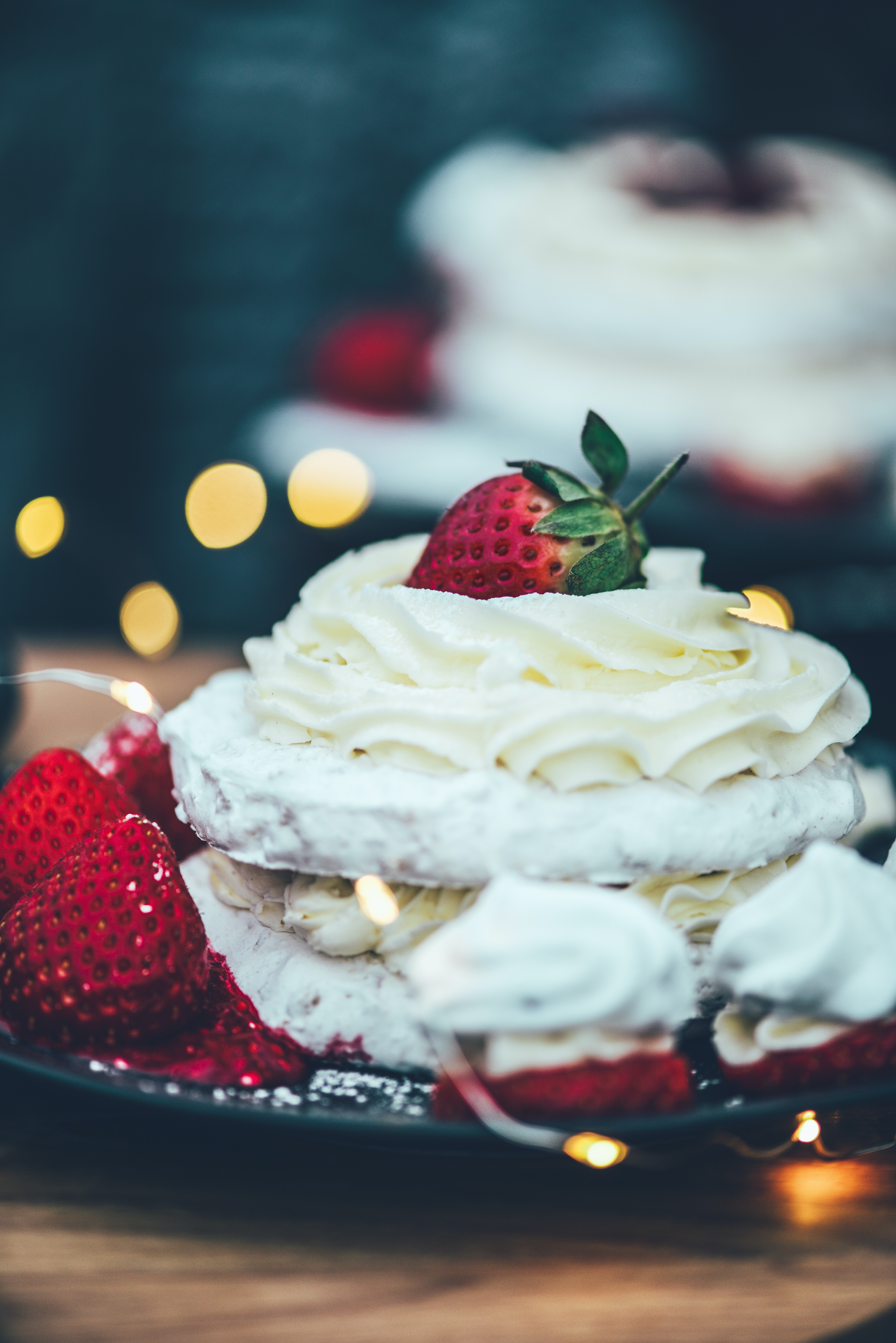 cake with icing and strawberries