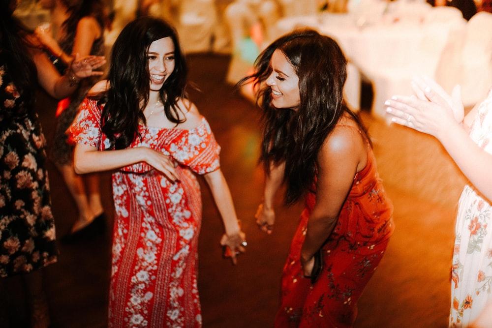 two women dancing on floor