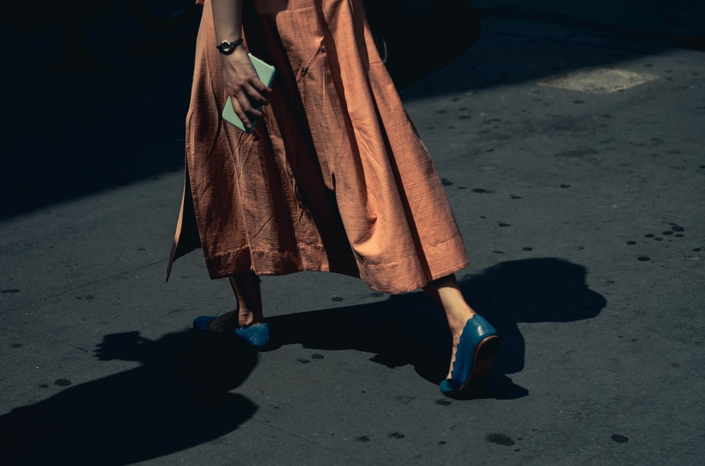 person wearing brown skirt