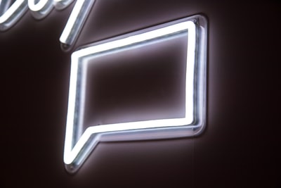 white neon light signage on wall message zoom background