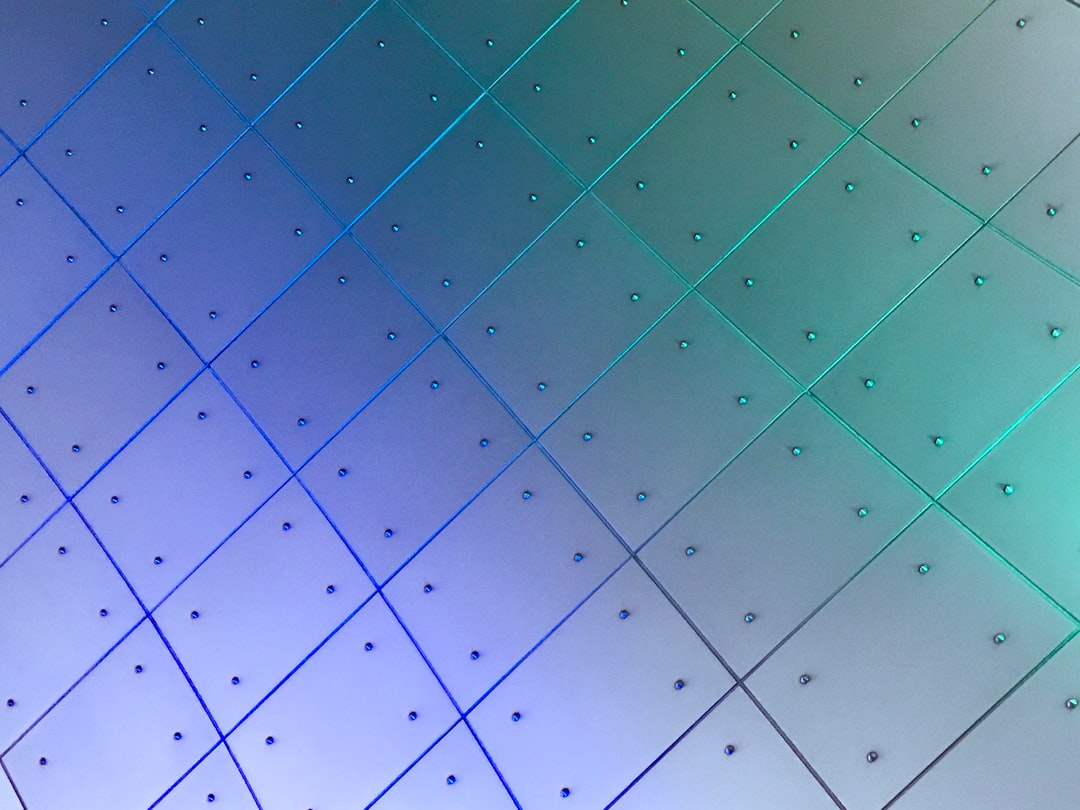 While visiting the Museum of Glass in Tacoma, Washington, I saw a blue light next to a green light shining on industrial metallic tiles in an arched hall and loved the gradient it created. I decided to shoot it at an angle to capture the pattern it produced and highlight the gradient from blue to green.