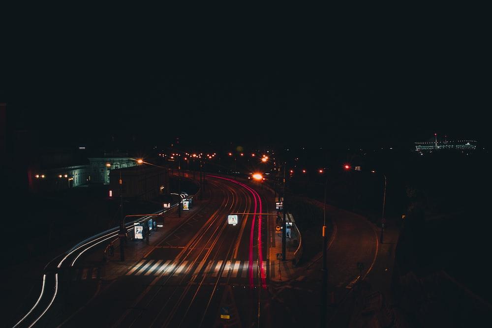 gray asphalt road way under night sky