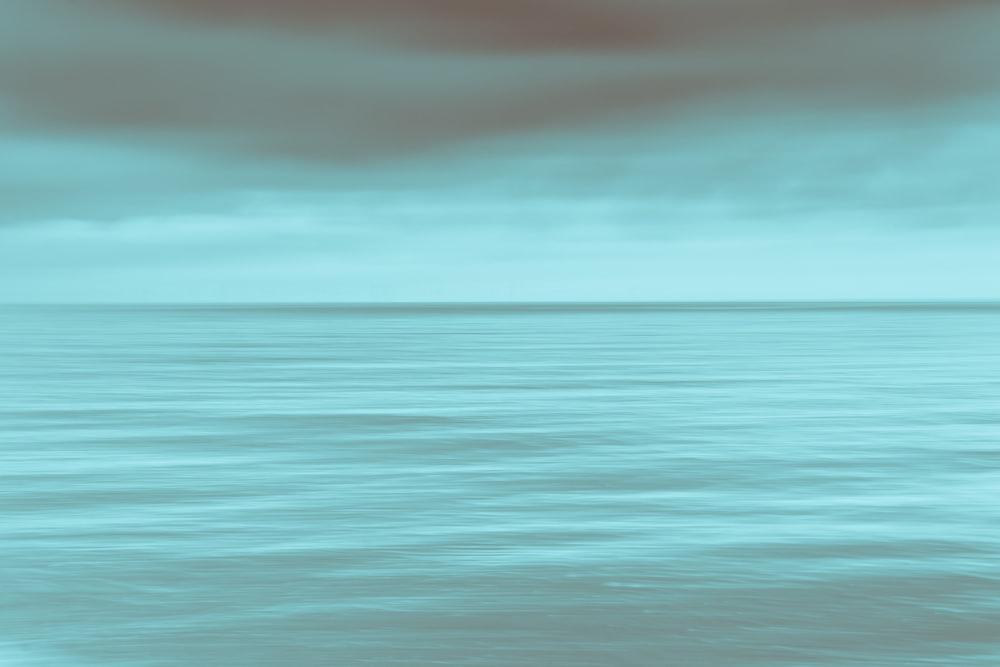 calm sea under gray clouds