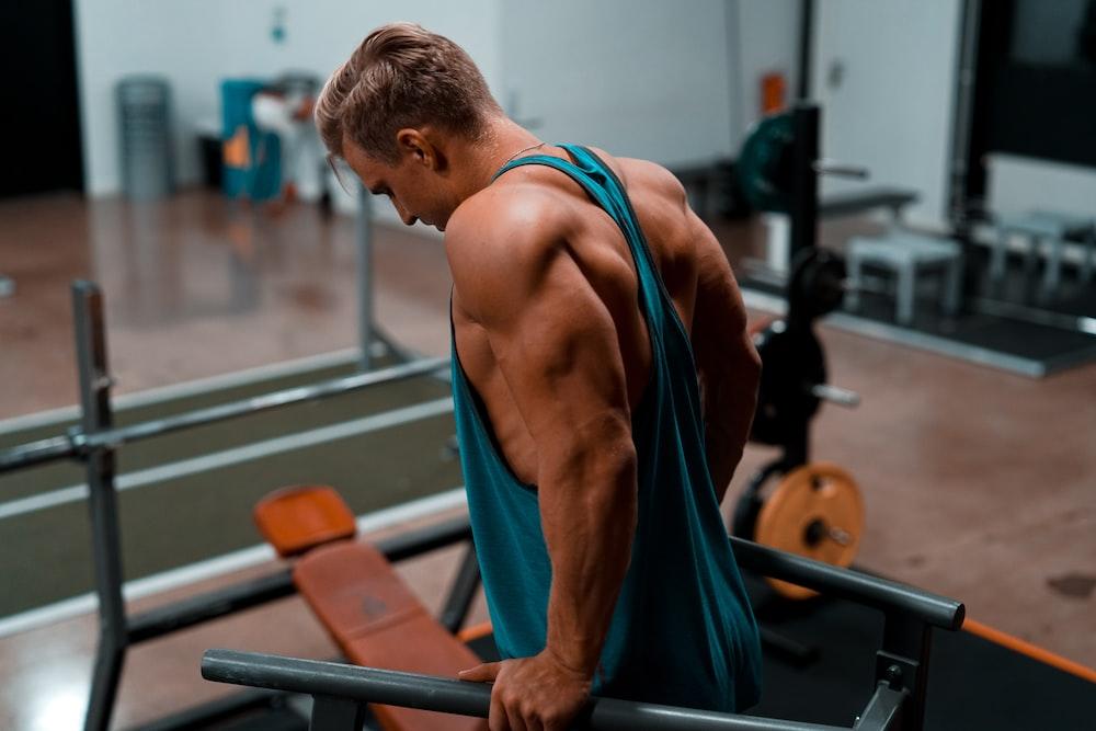 man exercising in dip station