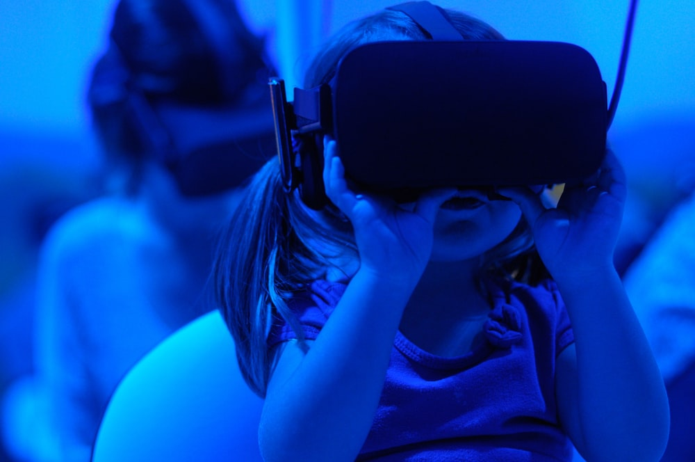girl using VR goggles