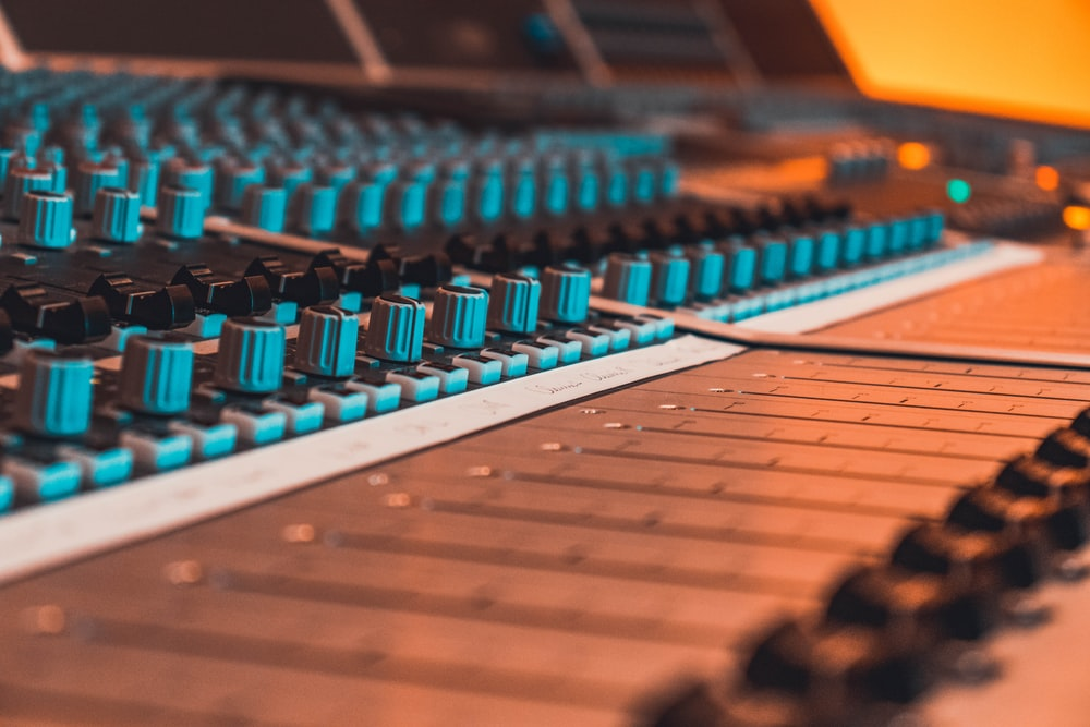 blue and black audio mixer in close-up photography