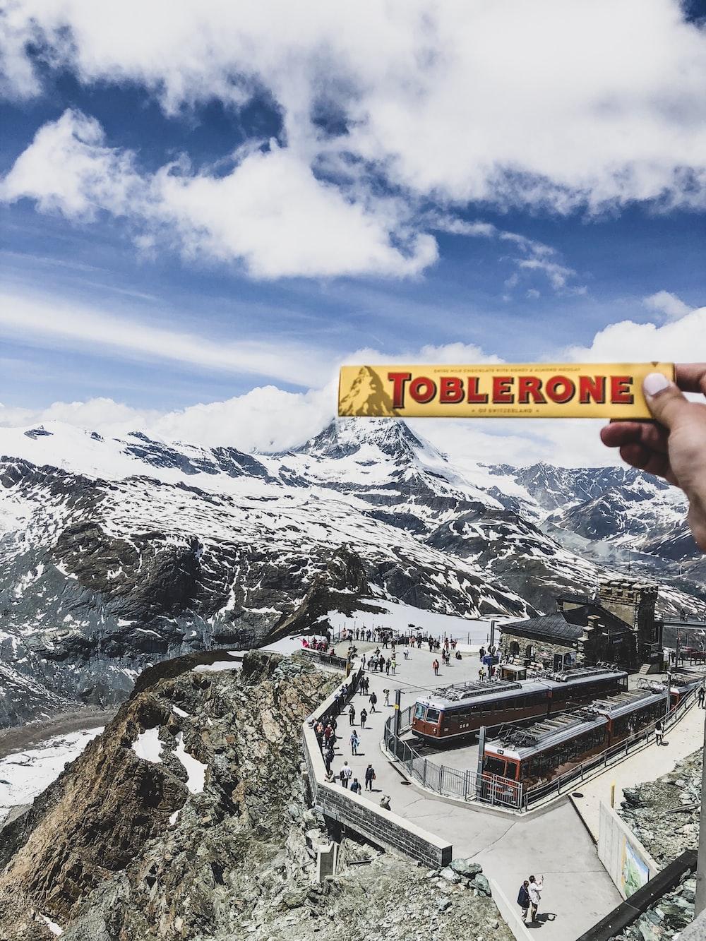 person holding Toblerone chocolate box