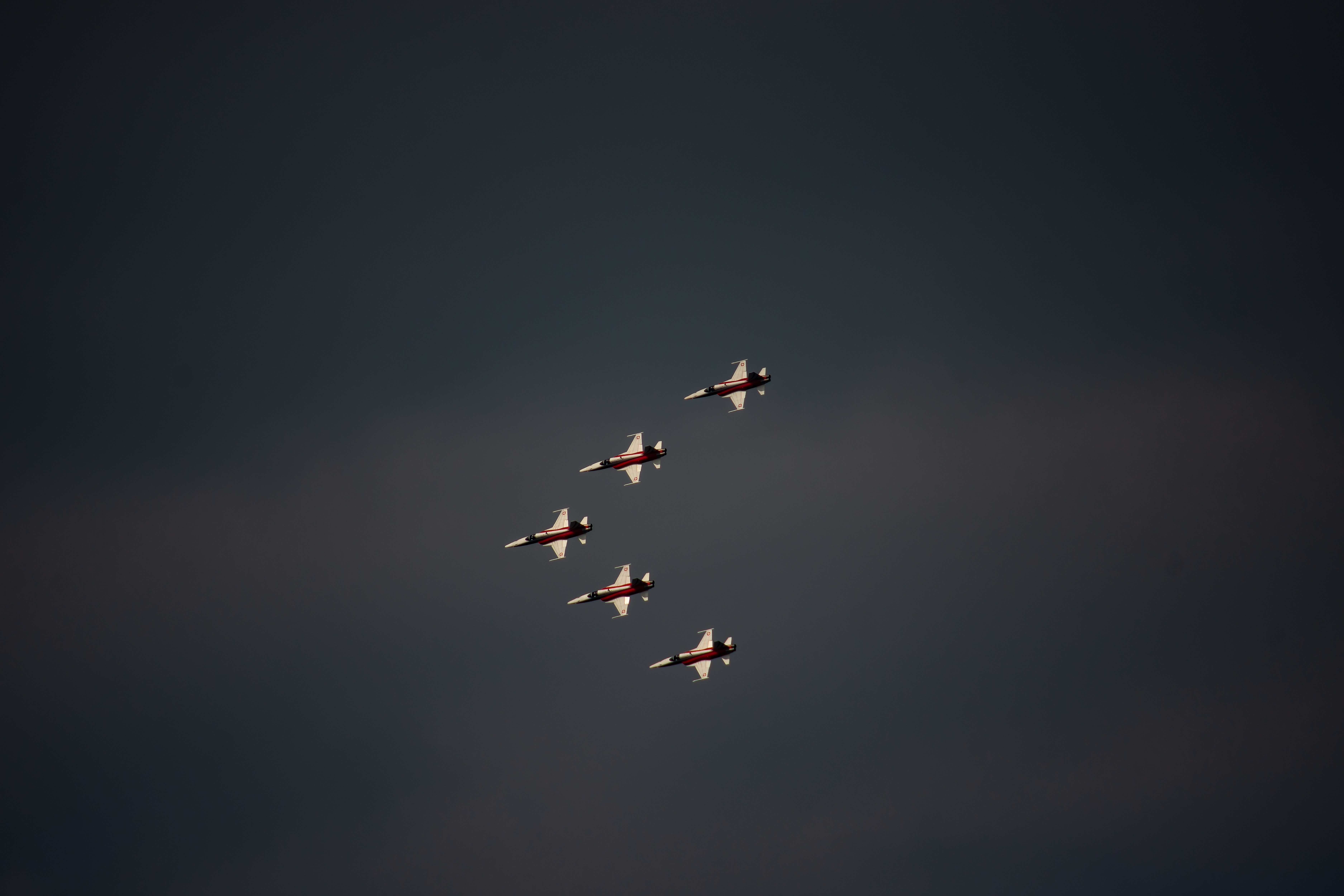 five airplanes having a formation