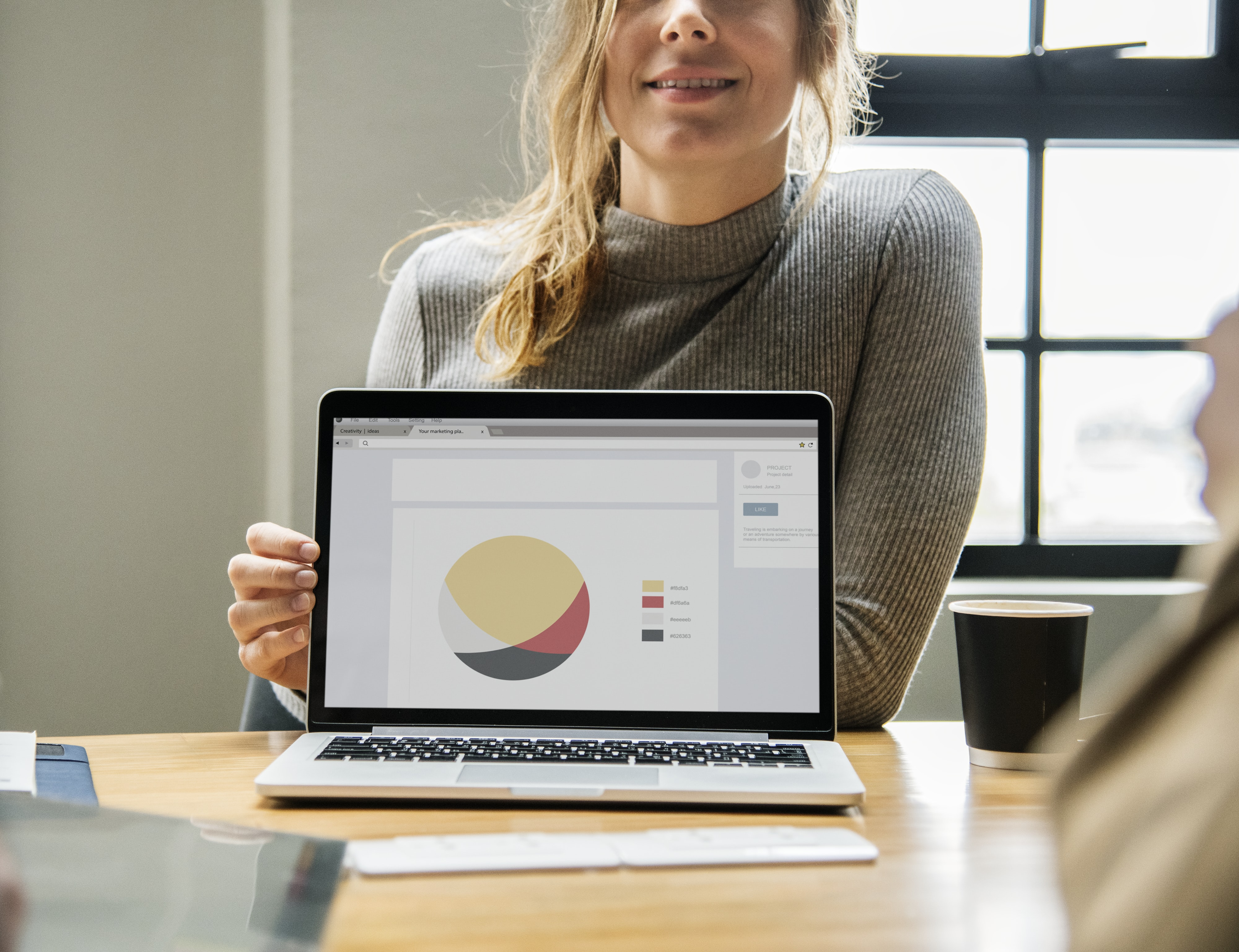 woman showing a presentation in MacBook Pro