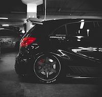 black 5-door hatchback on parking lot