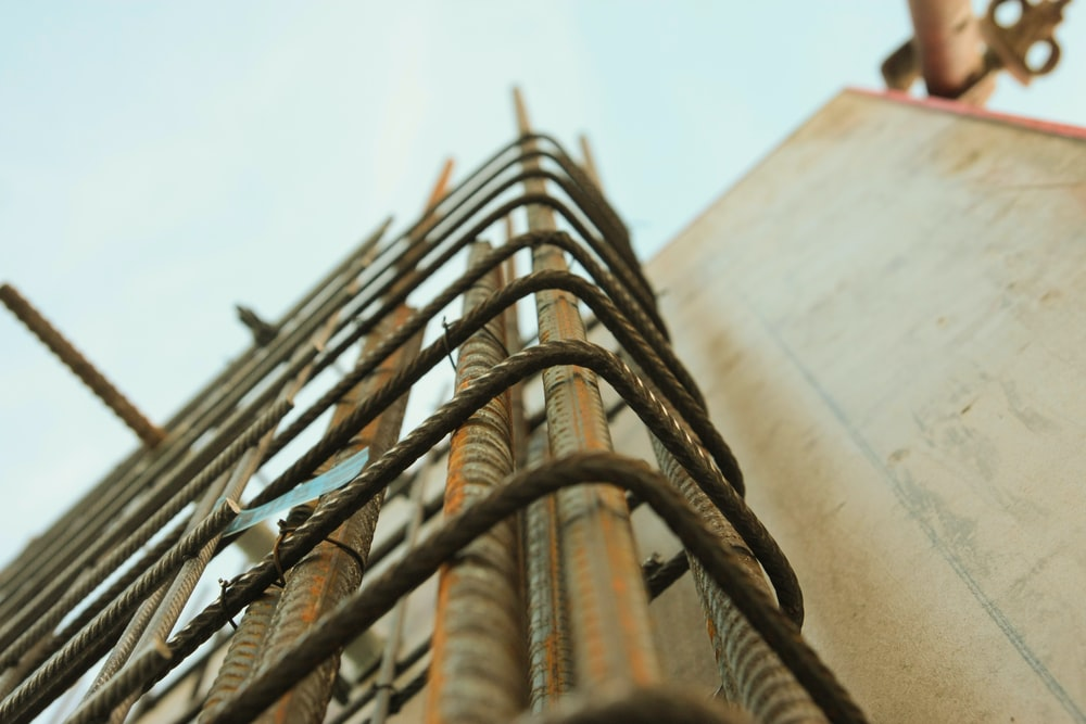 worm's-eye view photography of rebar