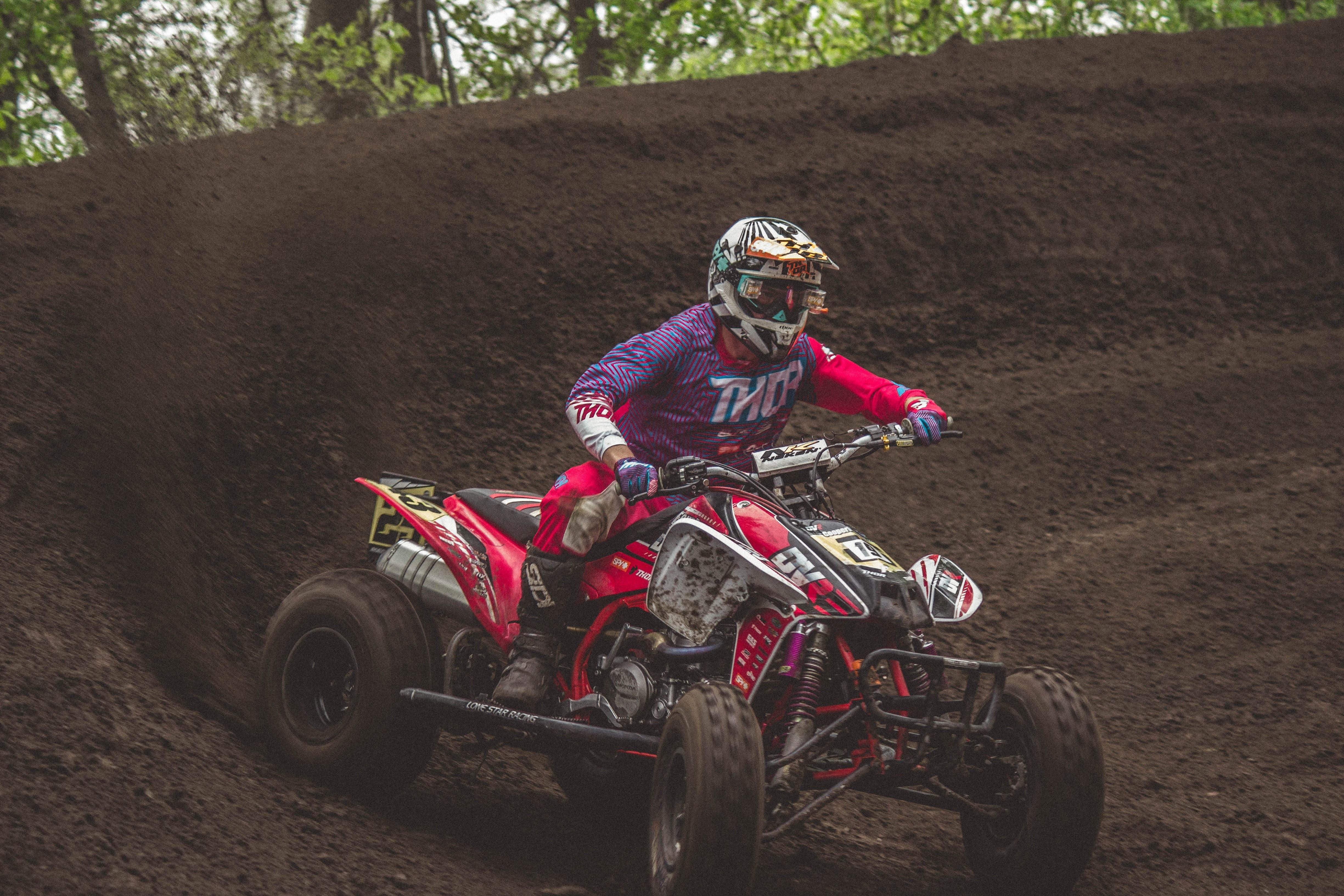 man riding ATV