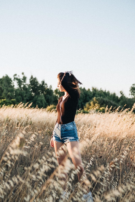 woman wearing blue short shorts
