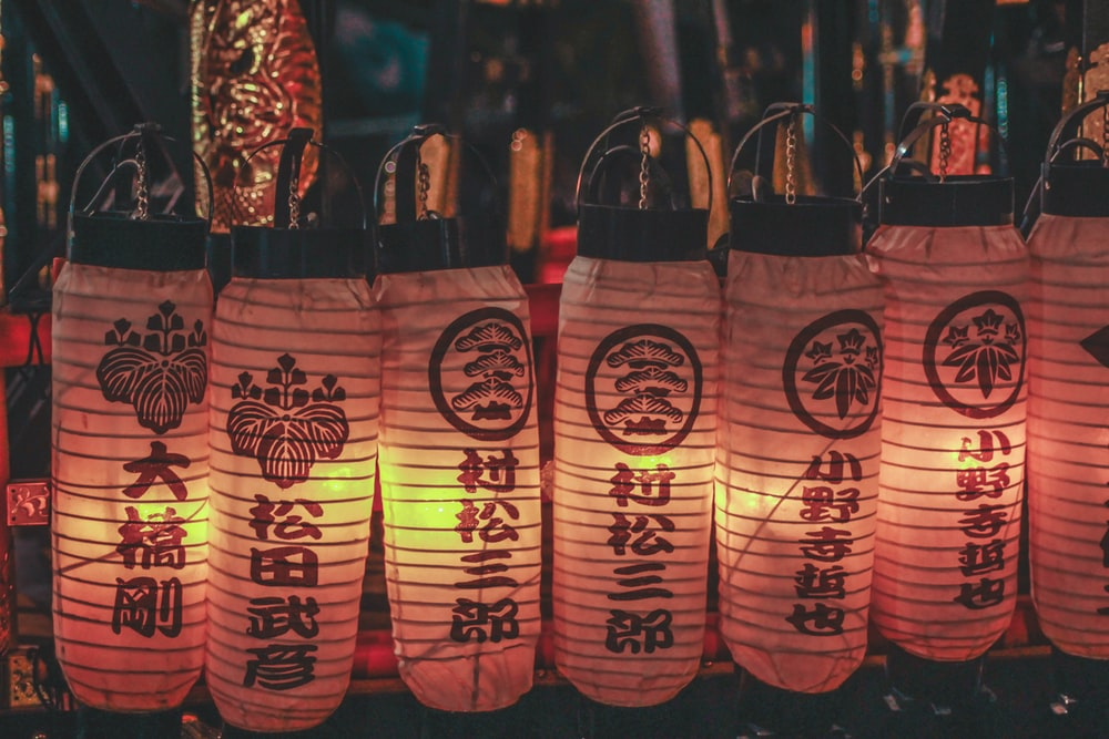 paper lanterns hanging on black steel hook