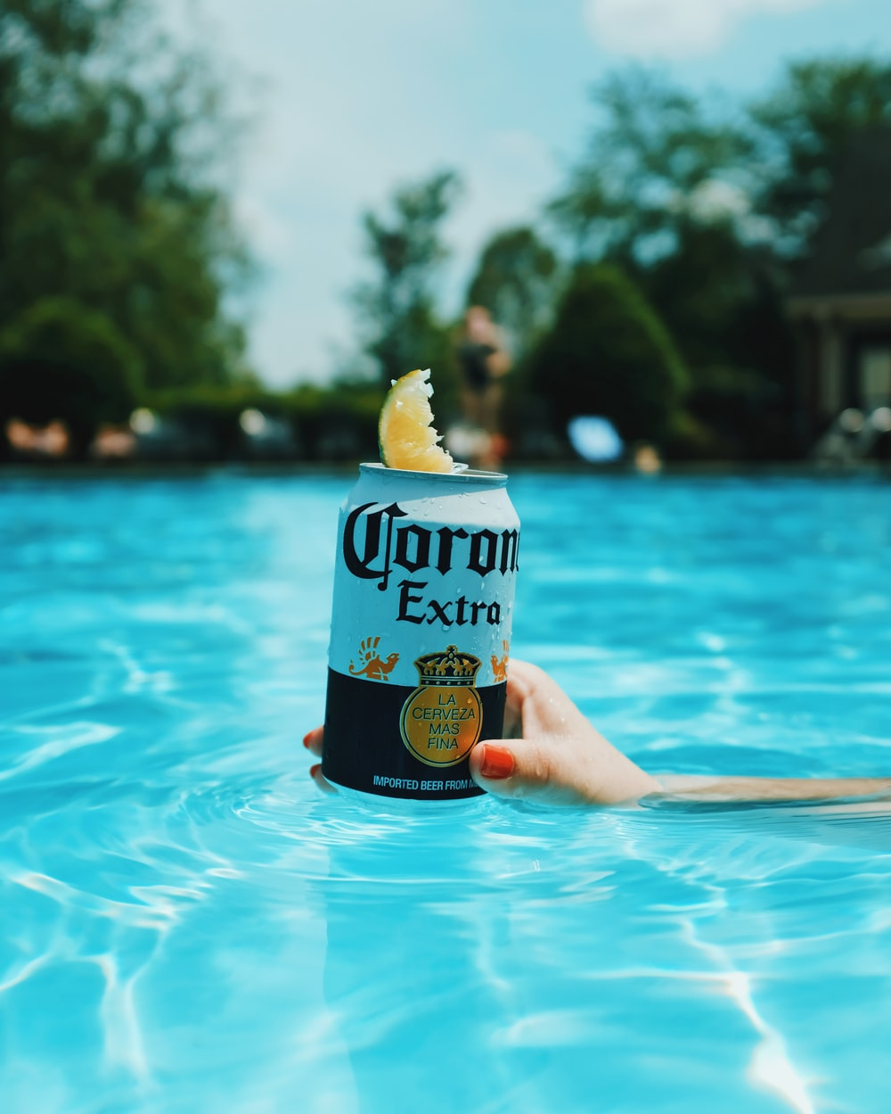 Corona extra beer can on swimming pool