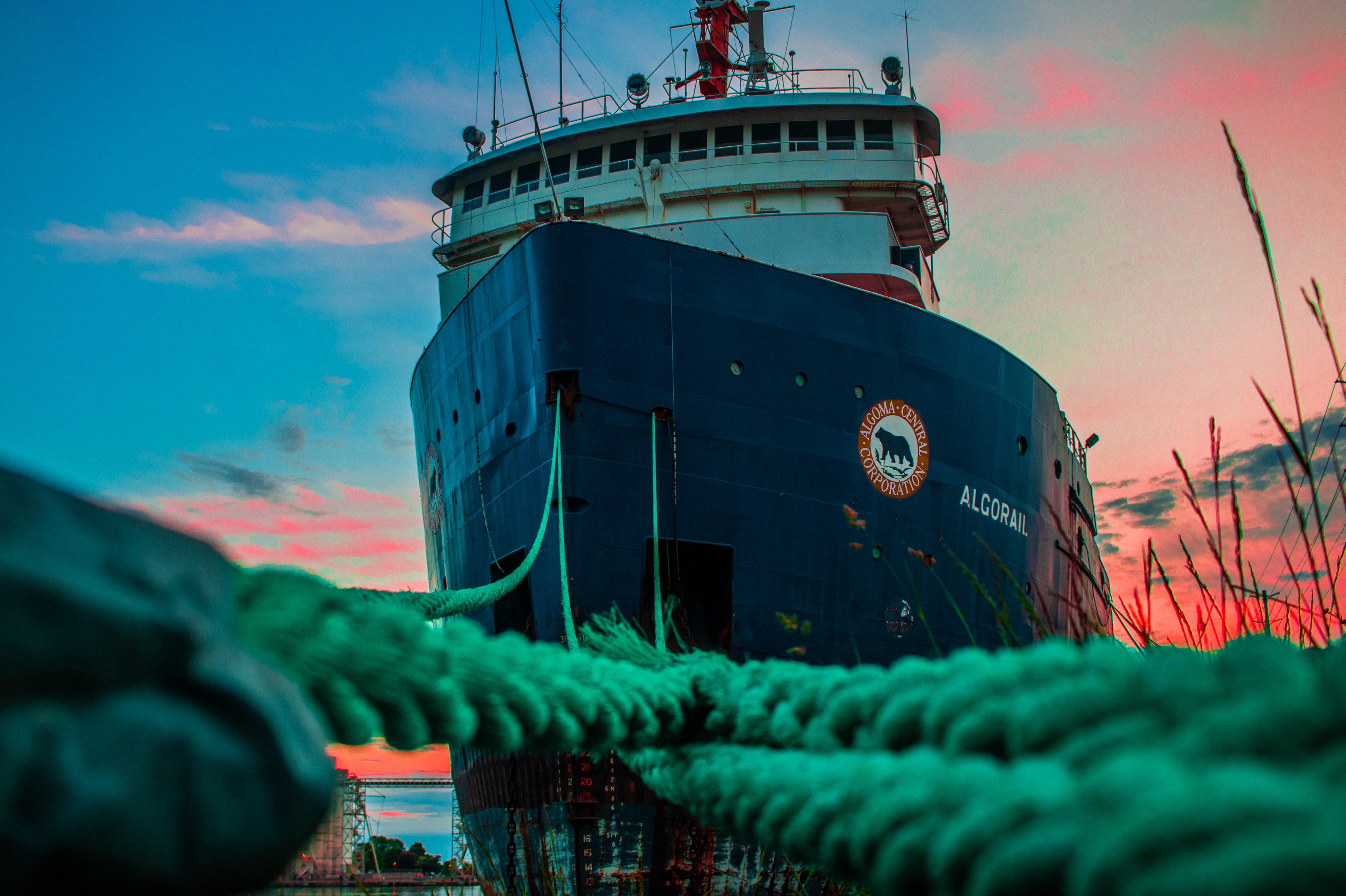 white and black ship on shipyard during daytime