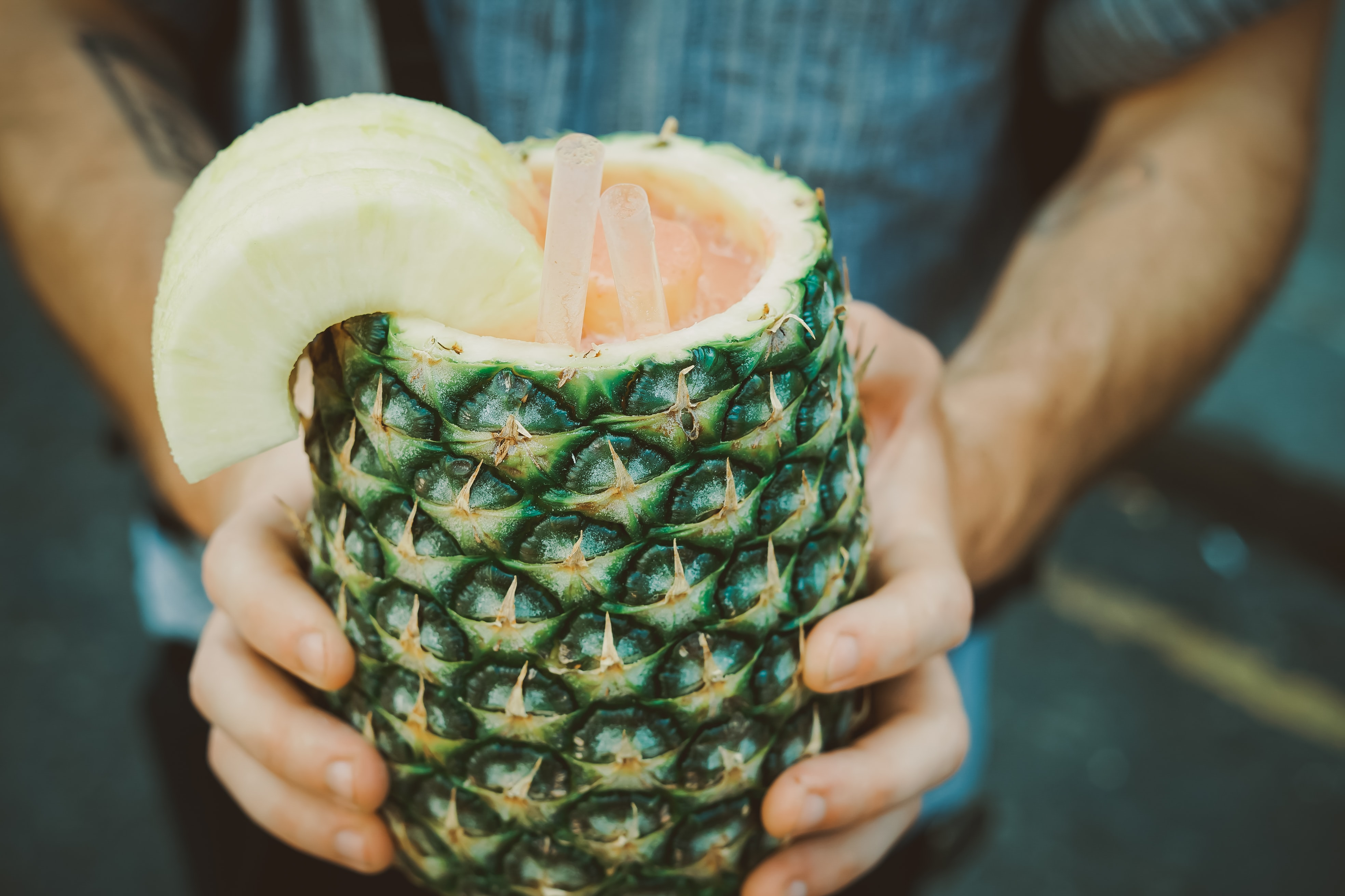 person holding carving pineapple