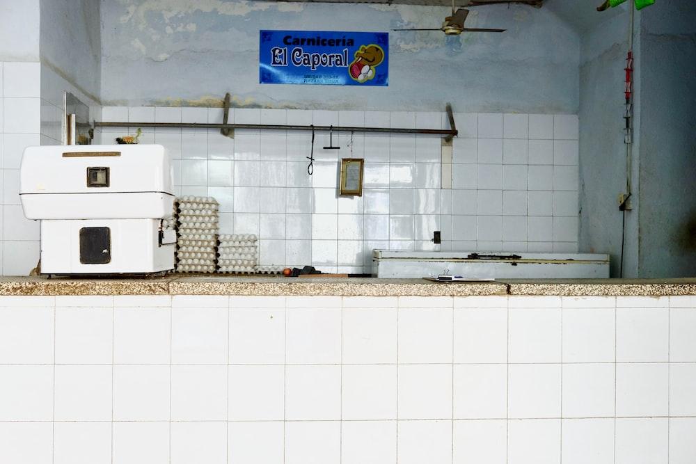 white machine near egg trays on white tiled table