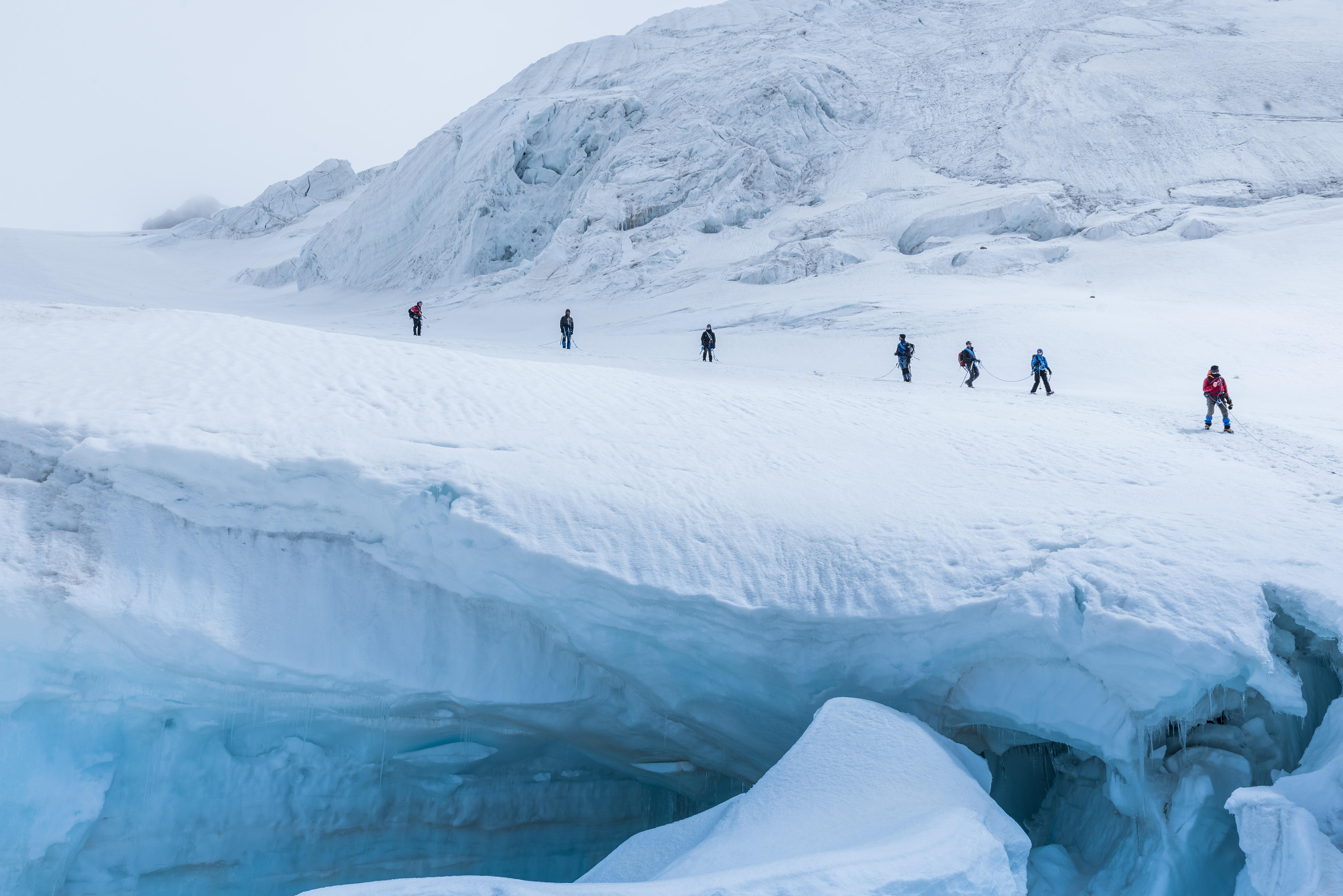 people walking on snow mountain during daytime