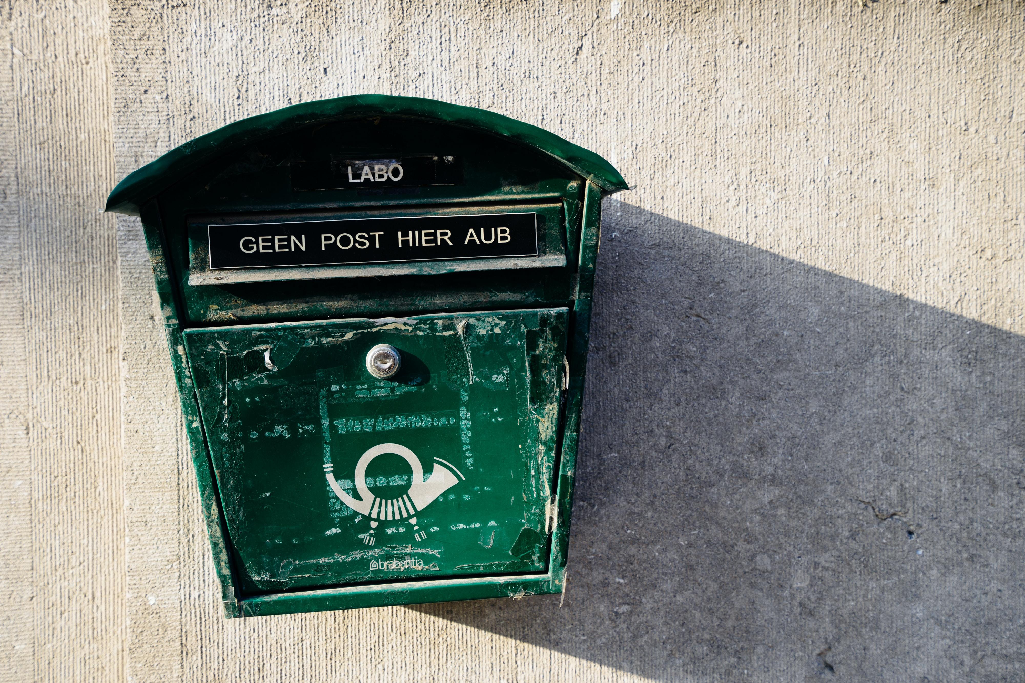 green wall mounted mailbox